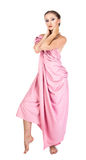 Toga. The girl dressed pink antique toga isolated on white Royalty Free Stock Images