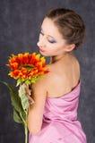 Toga and sunflower. Female dressed pink toga with orange sunflower Stock Photos