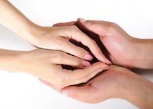 Togather de mains de femme et d'homme d'isolement Photo stock