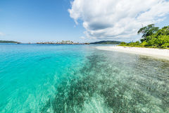 Togean Islands, transparent turquoise water and scenic beach Stock Photos