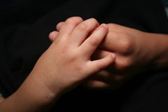 Together. Baby brother holding big brothers hand Royalty Free Stock Photos