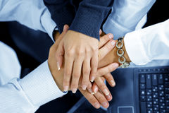 Together. Close up view of hands getting together in office environment Royalty Free Stock Image