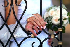 Together. Hands of bride and groom with golden rings Stock Images