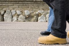 Together. Two people are walking together Royalty Free Stock Image
