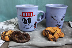 Together. Still life with candies and two valentine's cups - coffee and milk together as couple Stock Photos