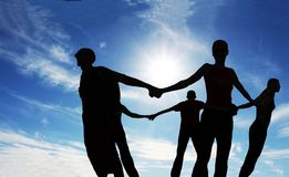 Together. Friends together -silhouette on blue background Royalty Free Stock Images