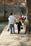 Together. Father holds his daughters hand as they walk the San Antonio Riverwalk Royalty Free Stock Photos