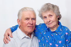 Always together. Happy old couple looking to the camera. over white Royalty Free Stock Photos