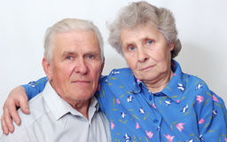 Always together. Happy old couple looking to the camera. over white Stock Photography