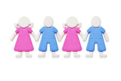 Together. A chain of rubber figurines of boys and girls isolated on white background Royalty Free Stock Photos