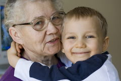 Together. Happy boy and grandma Stock Image