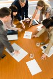Together. Team of confident people pointing to a business project at seminar Stock Photo