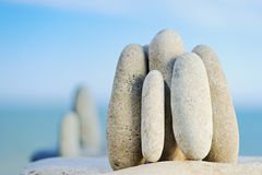 We together. The sea pebble stands vertically early in the morning Royalty Free Stock Image