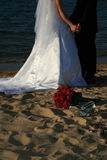 Together on the Beach. A bride and groom together on the beach Stock Photography