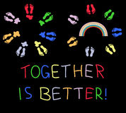 Together is better. Circles of colored footsteps with stains and rainbow Stock Images