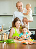 Together on the big kitchen preparing seafood Royalty Free Stock Photos