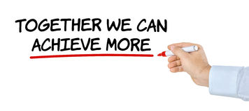 Together we can achieve more. Hand with pen writing Together we can achieve more Royalty Free Stock Image