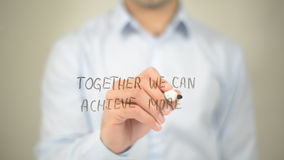 Together We Can Achieve More , man writing on transparent screen Stock Image