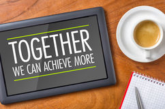 Together we can achieve more. Tablet on a desk - Together we can achieve more Stock Photos
