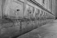 Fountain in Assisi. In assisi, Italy, an old fountain with twenty six spouts Stock Photos