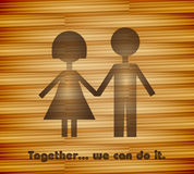 Together, we can do it!. A couple holding hands on a wooden background Stock Photography
