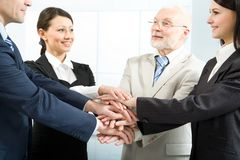 Together we can do everything!. Cheerful business people joining their hands Stock Images