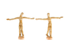 Together dancing. Wooden dolls together dancing over white background Stock Image
