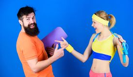 Together Everyone Achieves More. Athletic Success. Sport equipment. Strong muscles and body. Happy woman and bearded man stock photography