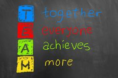 Together everyone achieves more colorful team text on chalkboard. Together everyone achieves more colorful team chalk text on chalkboard or blackboard as royalty free stock image