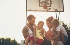 Always together. Family with basketball stock image