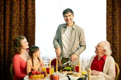 Together at festive table Stock Photos