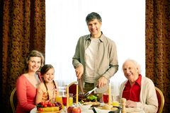 Together at festive table Royalty Free Stock Photo