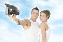 Together forever. Young couple dressed in white underwear tape their happy moment stock photography