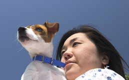 Together looking. Lady and dog looking away stock photo