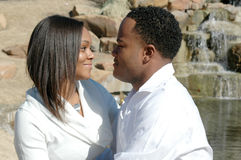 Together In Love. Young and attractive black couple in a park looking at each other face to face Stock Photos