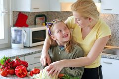 Together making salad. Girl learning to making the salad Royalty Free Stock Images