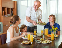 Together over healthy dining table Royalty Free Stock Images