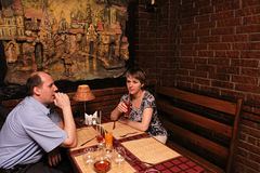 Together in restaurant. The man and the woman at restaurant Stock Photo