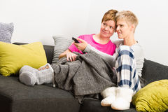 Together on sofa Stock Images
