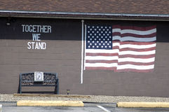 Together we stand. Painted on the wall of a VFW club.  The american flag and thewords together we stand Royalty Free Stock Images