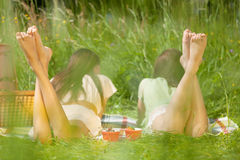 Together in sunshine. Two girls are resting in park Royalty Free Stock Photo