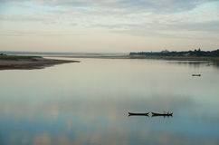 Together. Two boats on Irrawaddy river Royalty Free Stock Image
