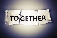 Together word on torn paper stapled back Royalty Free Stock Photography