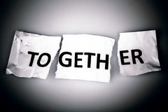 TOGETHER word written on torn paper Stock Photo