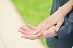 Togetherness. Hands of the groom and the bride Royalty Free Stock Images