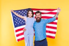 The togetherness of a family. Happy family celebrating independence day. Patriotic family of father and little daughter. Holding american flag. Family reunion royalty free stock images