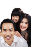 Togetherness of happy little family in studio Royalty Free Stock Images