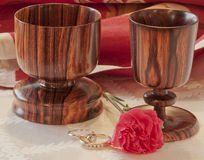 Togetherness--Wedding Rings & Wooden Goblets Stock Image