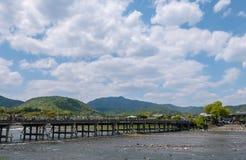 Togetsu-kyo, the Moon Crossing Bridge in Arashiyama. Togetsu-kyo, known as the Moon Crossing Bridge is a 155-meter bridge over the Katsura River in Saga Royalty Free Stock Photo