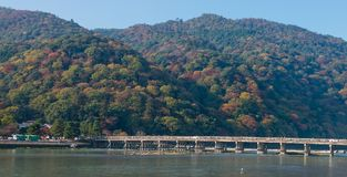 Togetsukyo bridge and Hozu river in autumn season. Togetsukyo bridge and Hozu river in autumn season, Kyoto, Japan Royalty Free Stock Image